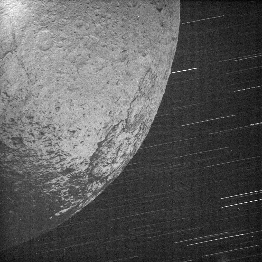 This almost surreal view of Iapetus was acquired by Cassini about 10 minutes after the spacecraft's closest approach to the icy moon during a close flyby on New Year's Eve 2004.