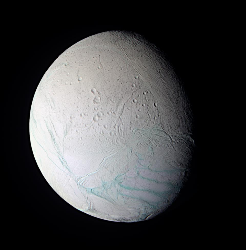 As Cassini approached the intriguing ice world of Enceladus for its extremely close flyby on July 14, 2005, the spacecraft obtained images in several wavelengths that were used to create this false-color composite view.