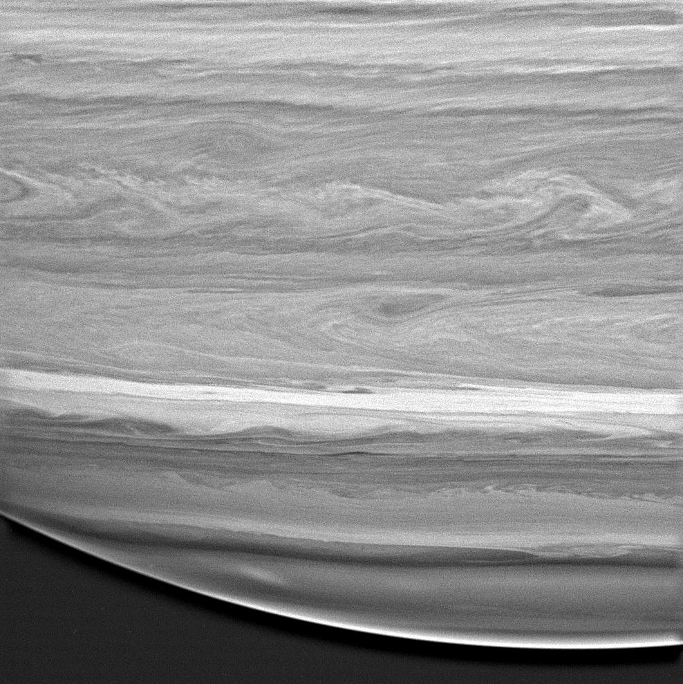 black and white image of saturn showing cloud swirls and details
