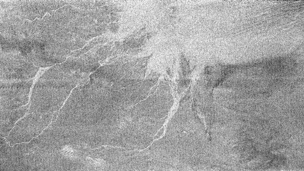 White lines that could be channels in which fluid flowed from the slopes of Circus Maximus on Titan