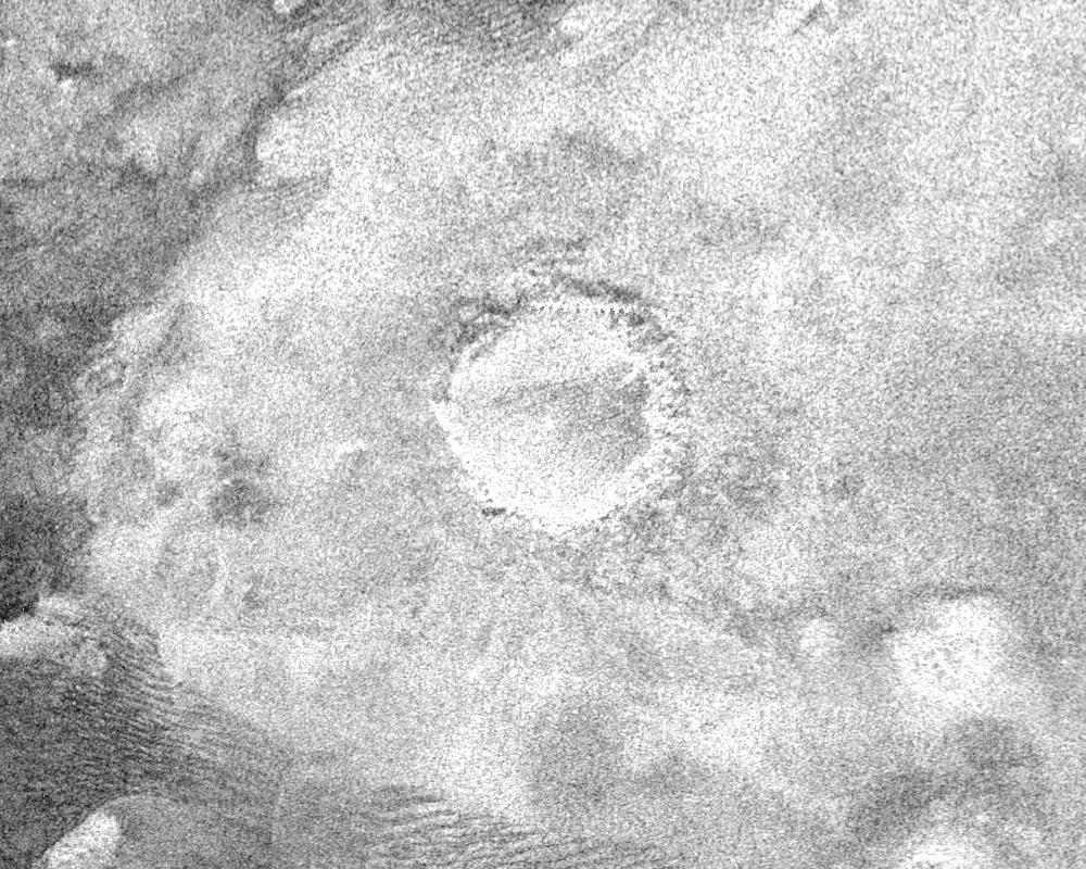Crater on Titan surrounded by bright blanket of material