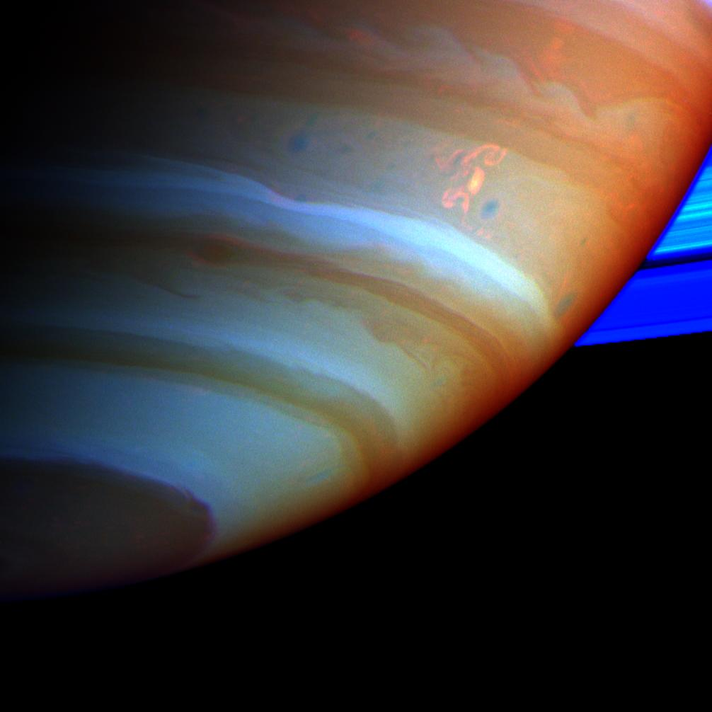 Colorful close-up of Saturn showing the 'Dragon Storm'
