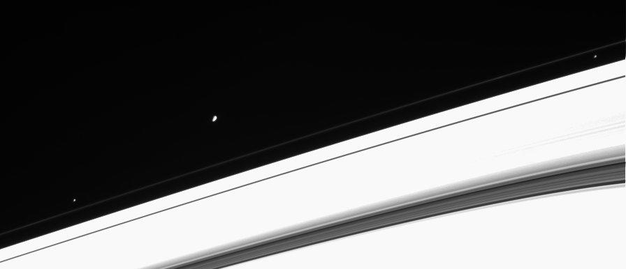 Three of Saturn's moons near the rings