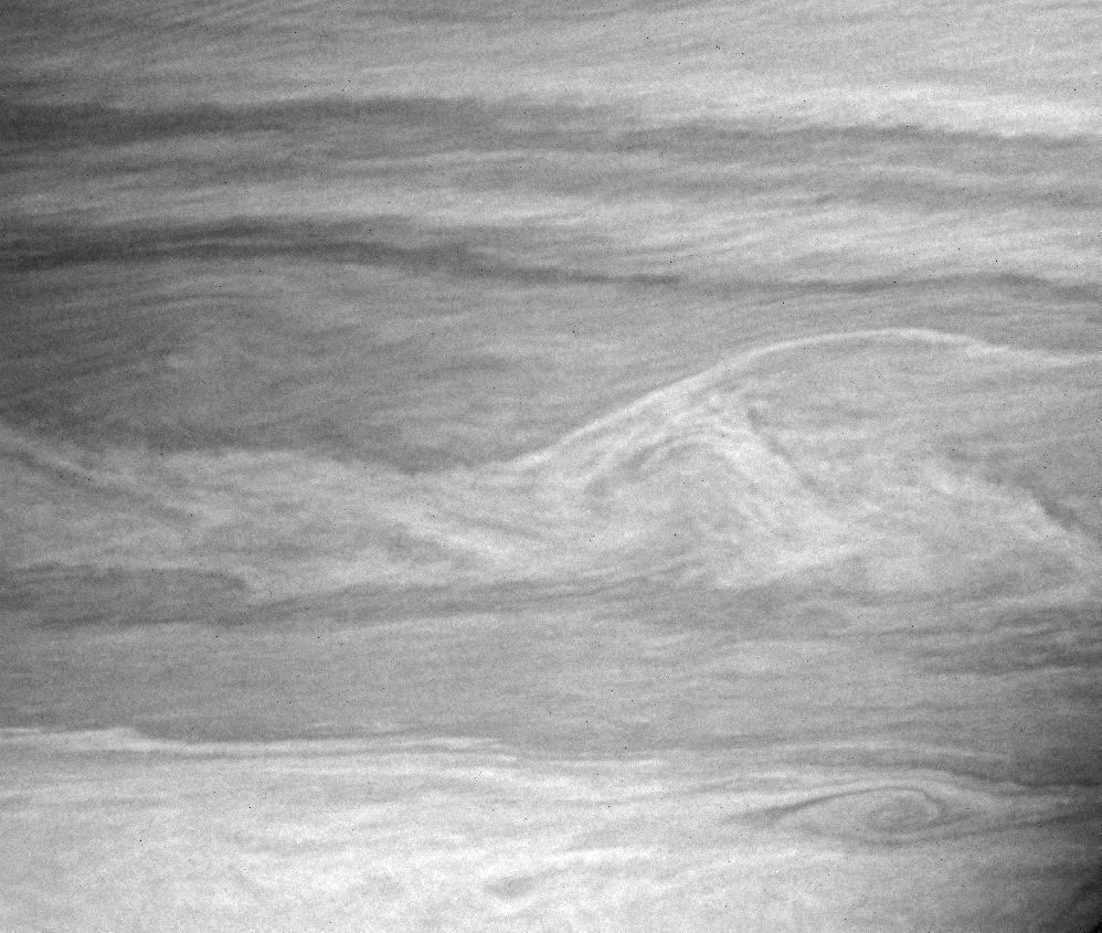 Vortices and wavy interfaces on Saturn