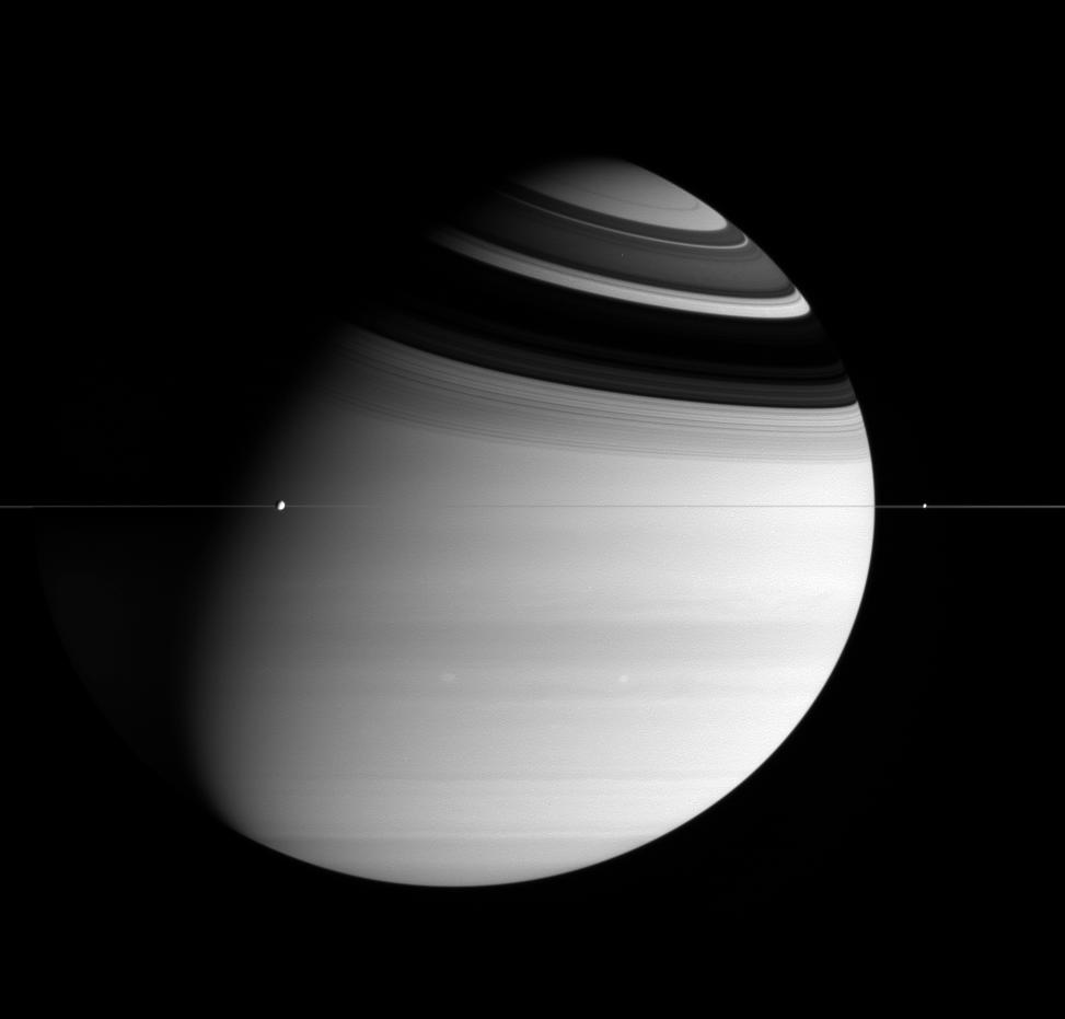 Saturn, the extremely thin rings, and two moons