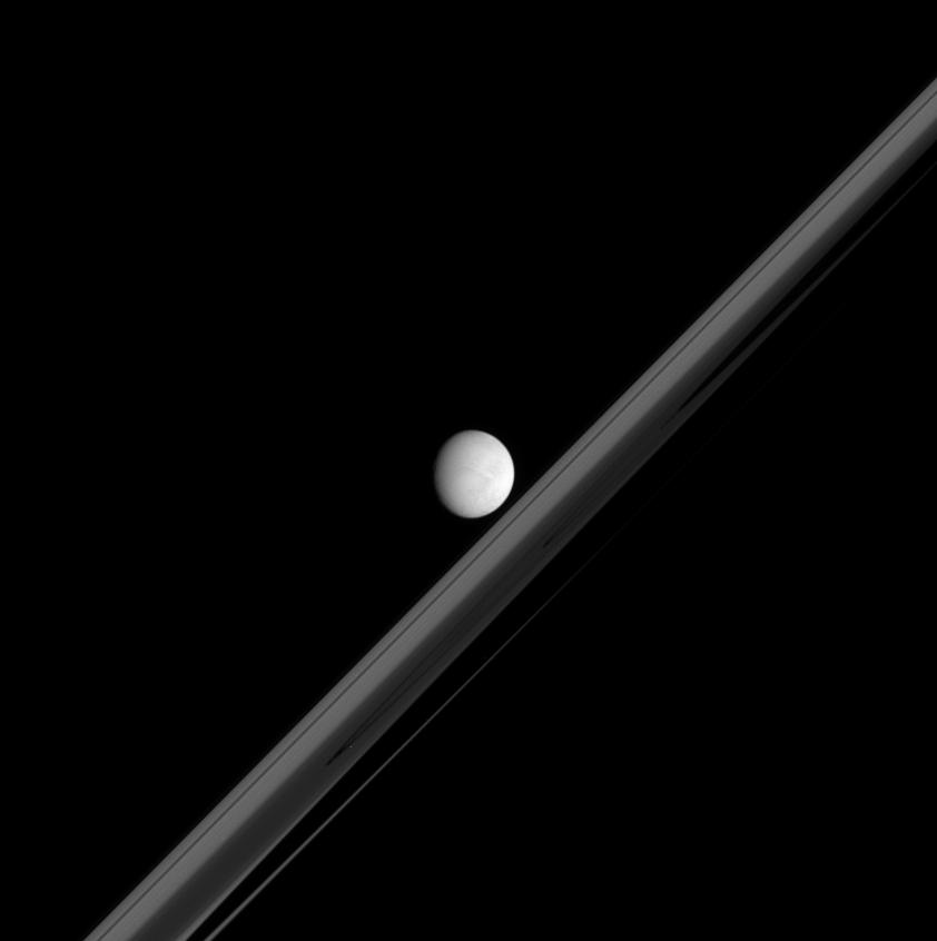 Enceladus in front of Saturn's Ring