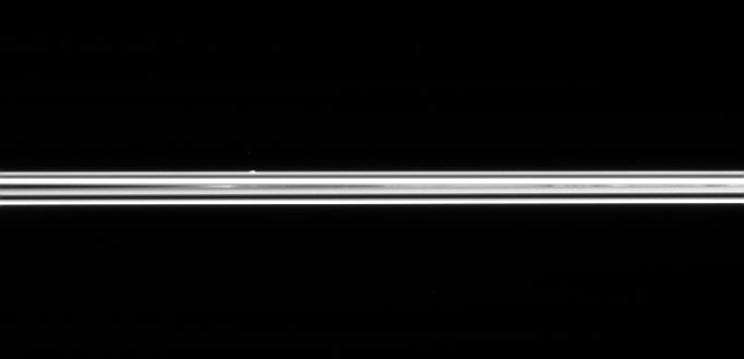 The small ring moon Atlas, on the far side of Saturn's immense ring system