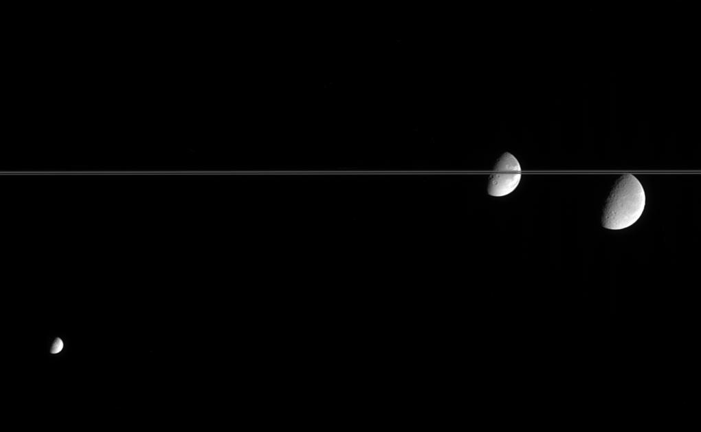 Three of Saturn's moon near the rings