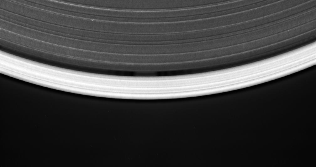 This movie sequence consists of 12 images taken over 16 minutes while Cassini gazed down upon the sunlit side of the A ring, shows a tiny moon orbiting in the center of the Keeler gap, churning up waves in the gap edges as it goes.
