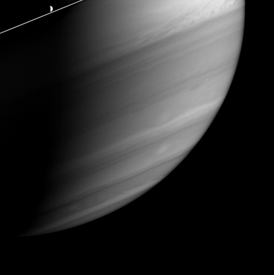 Dione just above Saturn's ringplane