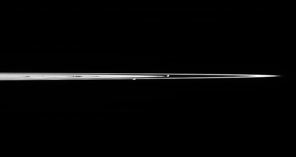 Prometheus and Pandora are captured here in a single image taken from less than a degree above the dark side of Saturn's rings.