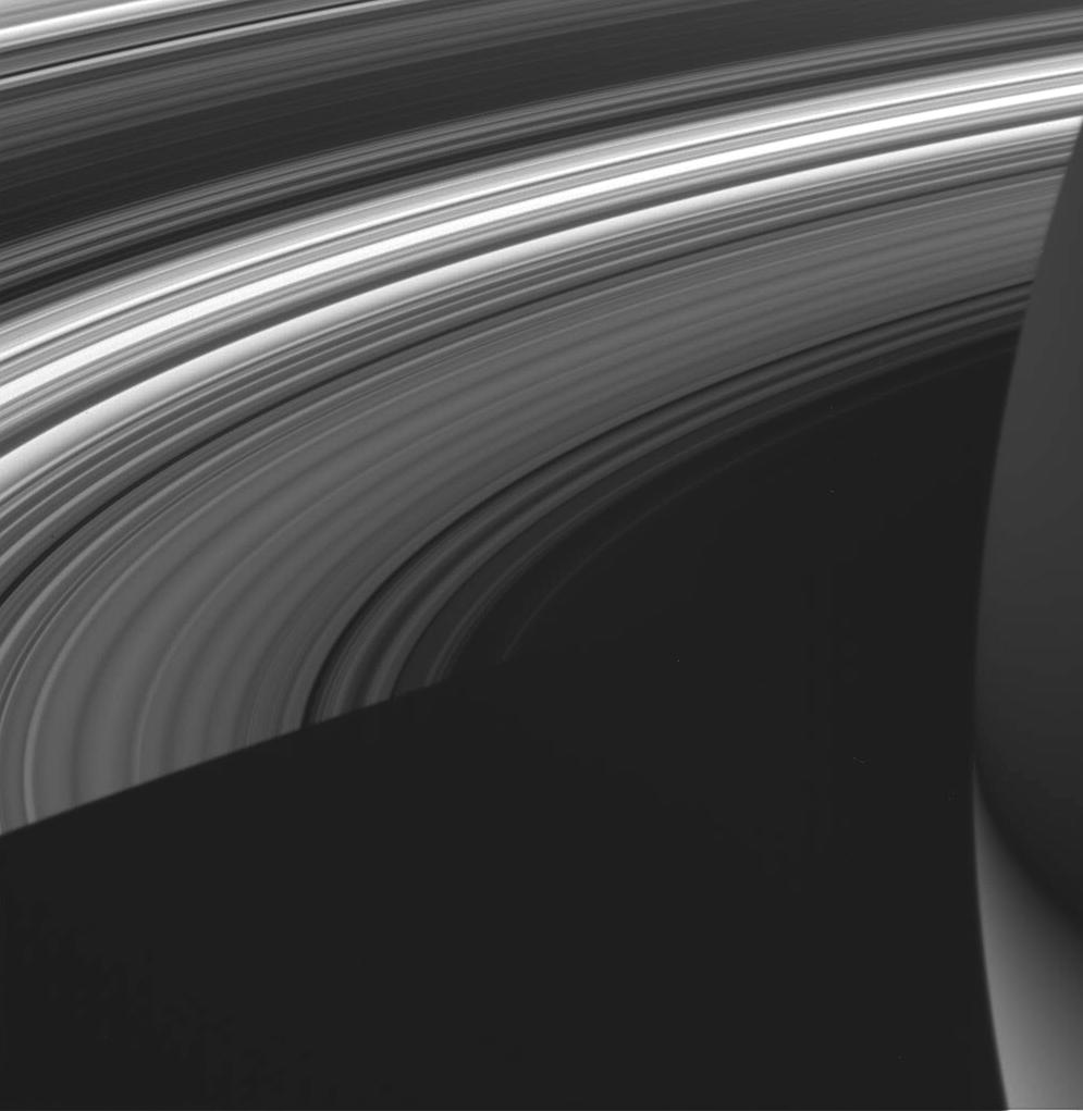 This view shows the unlit side of Saturn's rings made visible by sunlight filtering through the rings from the lit side