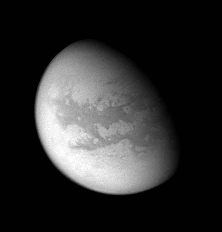 This processed image of Titan reveals mid-latitudes on the moon's Saturn-facing side