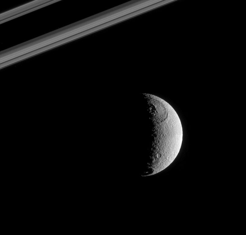 Tethys near a portion of Saturn's rings