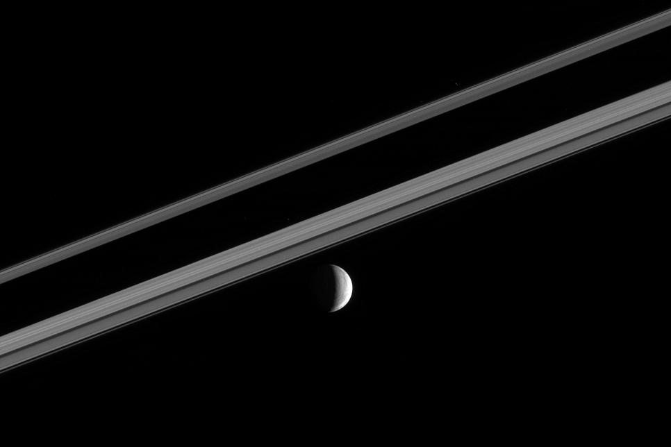 Enceladus near a part of Saturn's rings