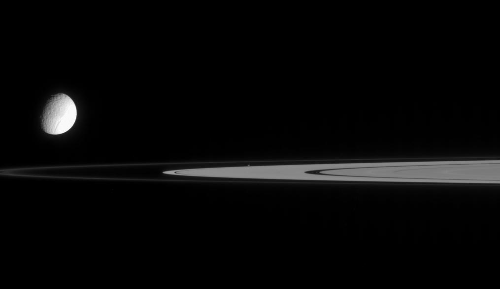 Tethys, Saturn's rings, and tiny Atlas