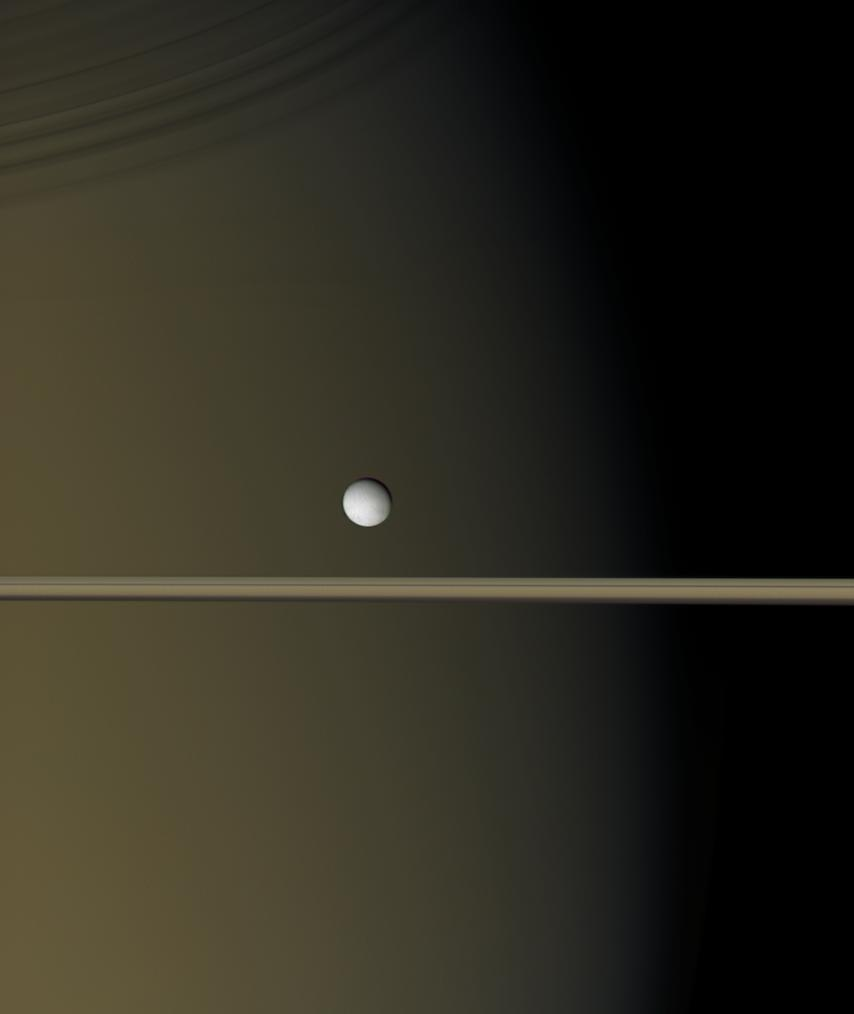 Enceladus by Saturn and the rings
