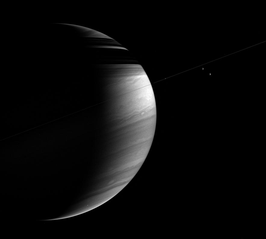 The tilted crescent of Saturn