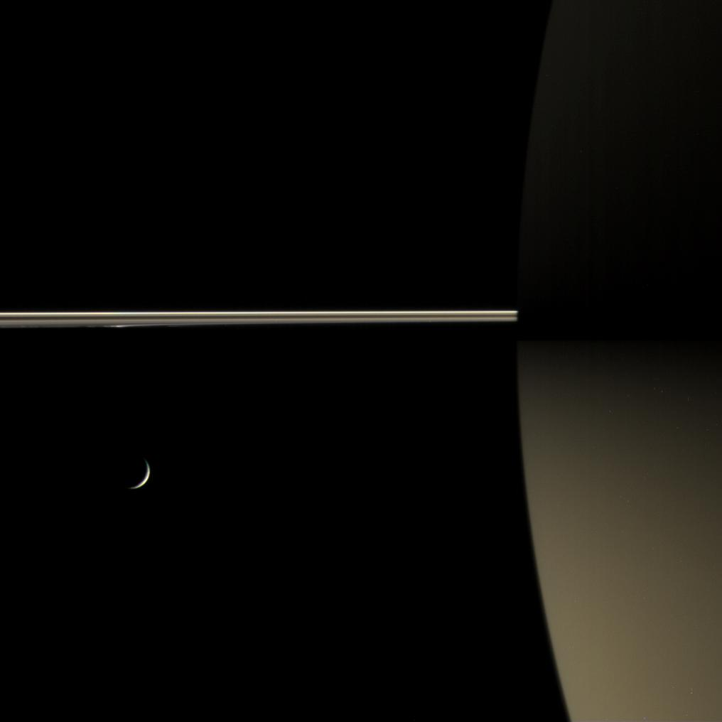 This color view of Saturn's night side shows how the rings dimly illuminate the southern hemisphere