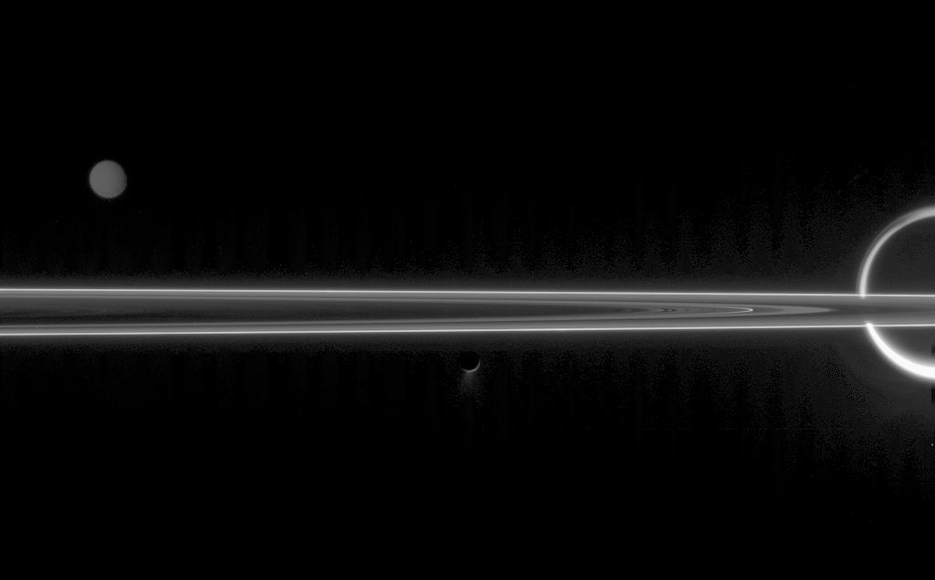 The unlit side of the rings, with Titan, Tethys and Enceladus