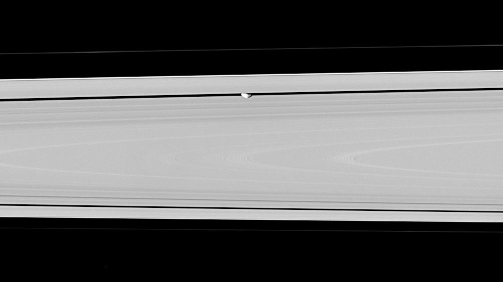 Saturn's moon Pan, partly in shadow and party cut off by the outer A ring