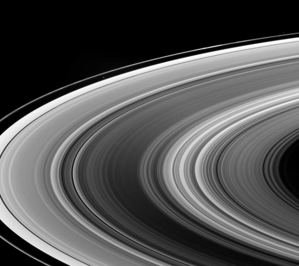 This view looks down onto the unlit side of Saturn's ringplane. Atlas and Pandora are also visible.