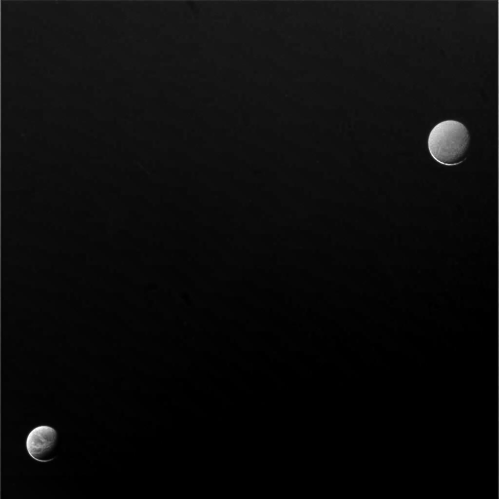 Dione (lower left) and Rhea (upper right)