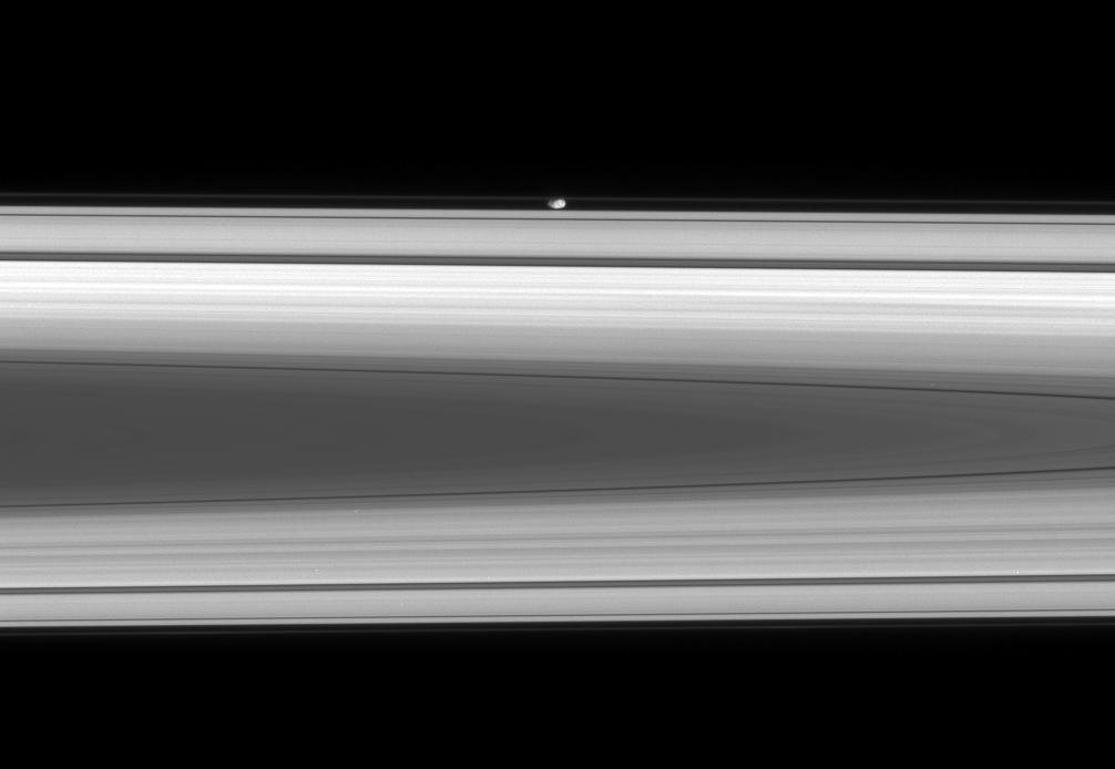 The flattened, potato-like form of Prometheus glides silently within the Roche Division, between Saturn's A and F rings.