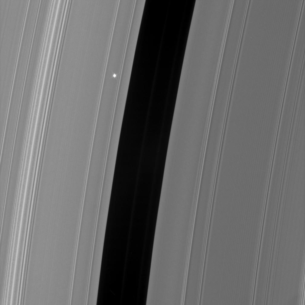 The bright red giant star Aldebaran slip behind Saturn's rings