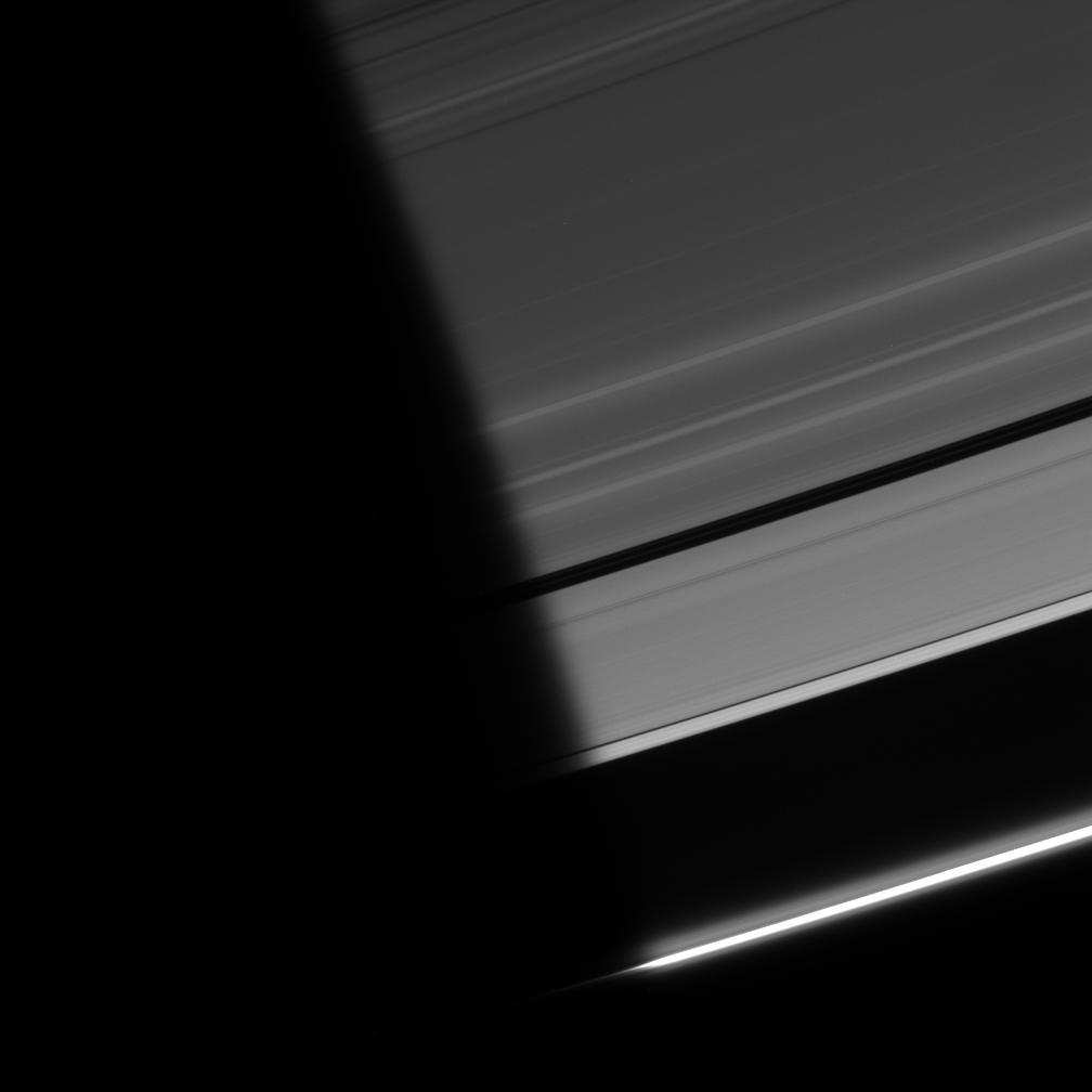 Ring particles emerge from the darkness of Saturn's shadow