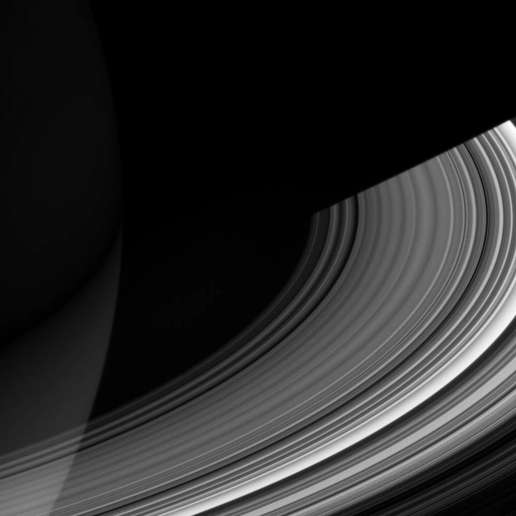 The C ring sweeps out of the darkness of Saturn's shadow