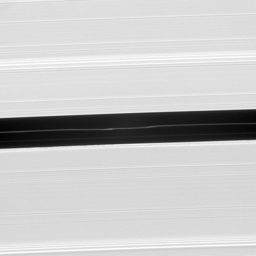 A faint ringlet drifting through the center of the Encke Gap