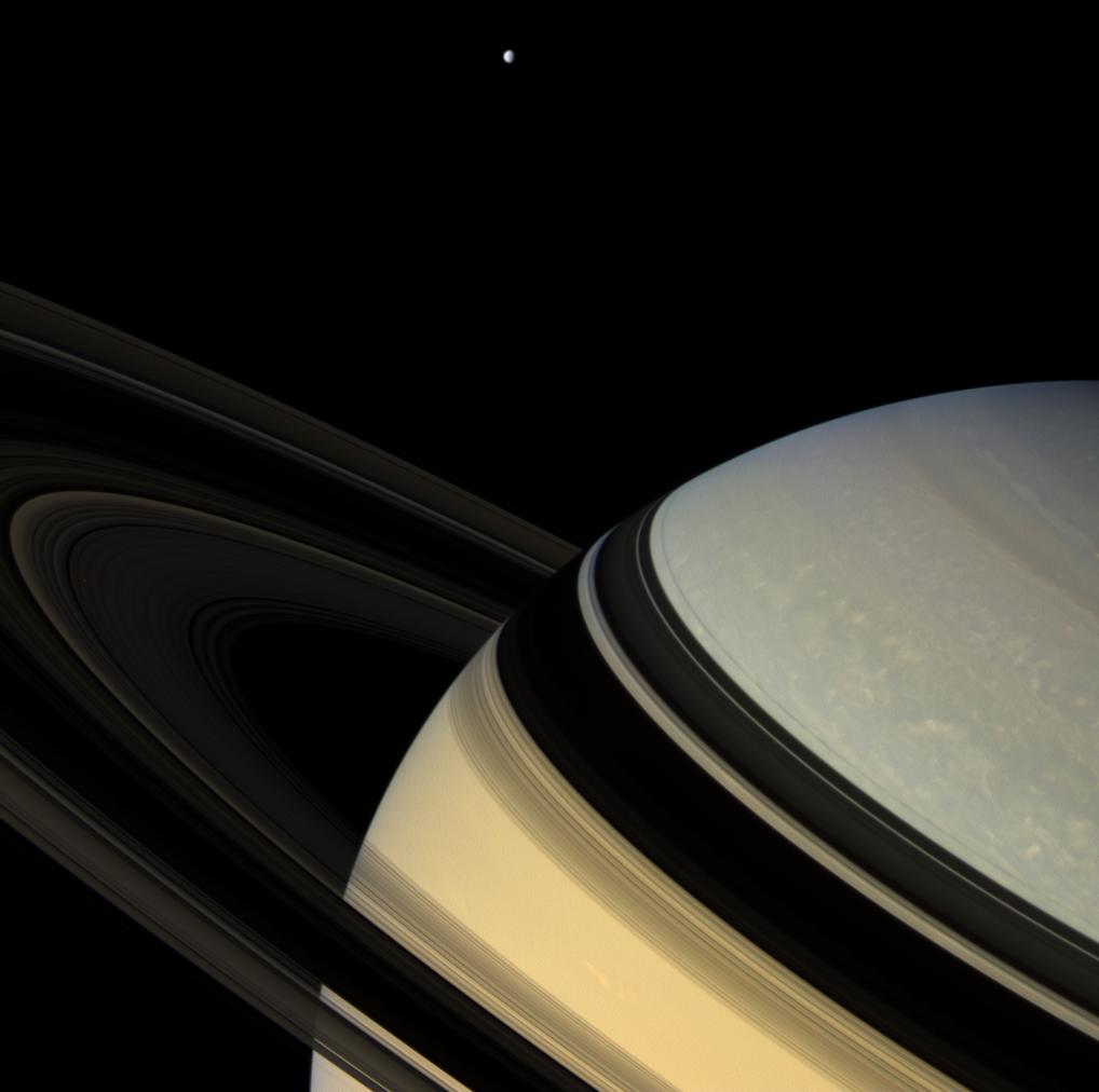 Saturn, it's rings, and Dione