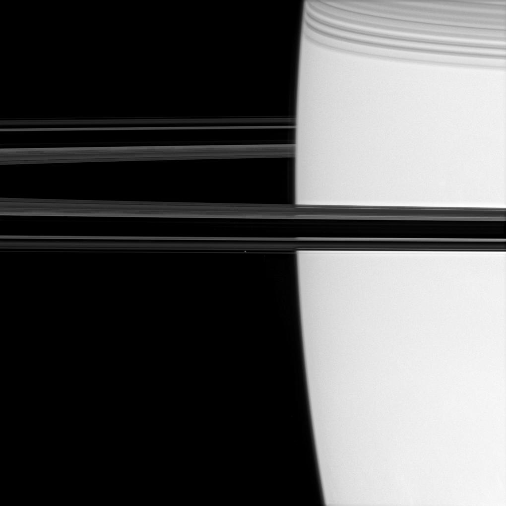 Saturn, its rings and the moon Atlas