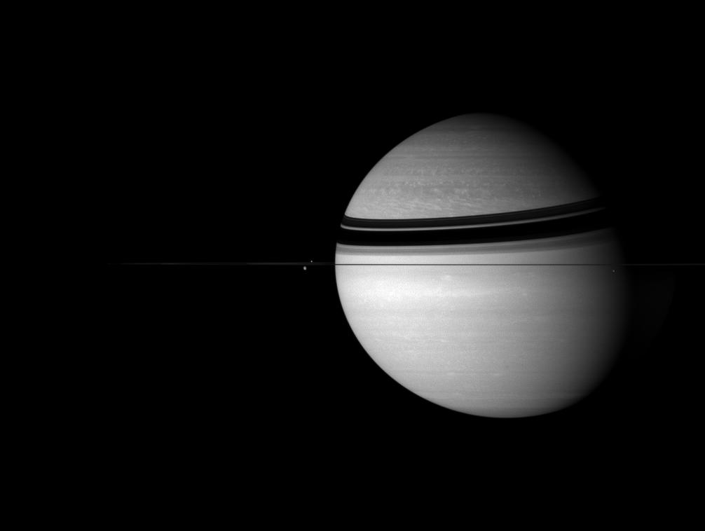 Saturn and three of its moons