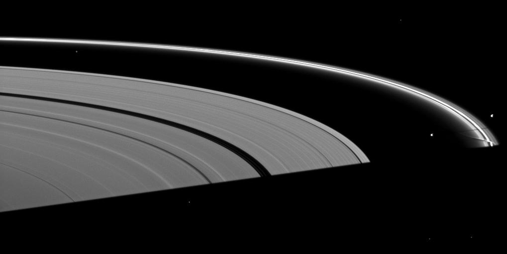 Saturn's moon Prometheus casts a shadow near a streamer-channel created by the moon in the thin F ring in this image taken about a month after the planet's August 2009 equinox.
