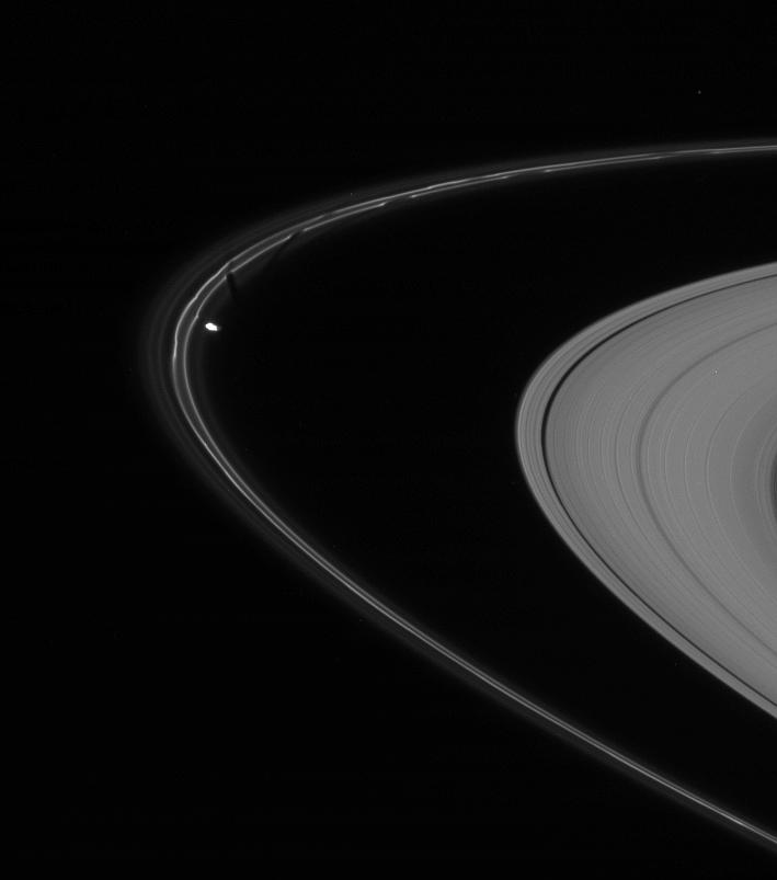 Prometheus is caught here, in the act of pulling a new streamer out of the F ring's inner edge