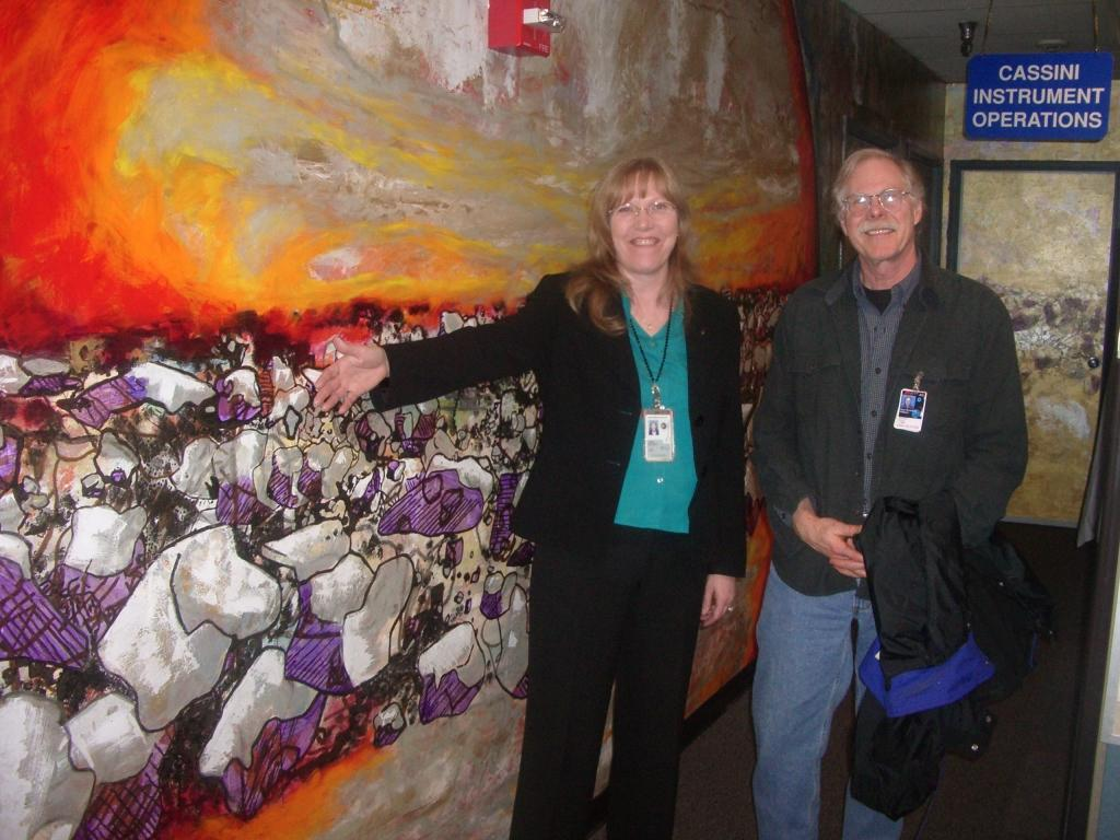 Linda Spilker, Cassini deputy project scientist, and Jeff Cuzzi, Saturn ring specialist, stand in front of a section of the mural