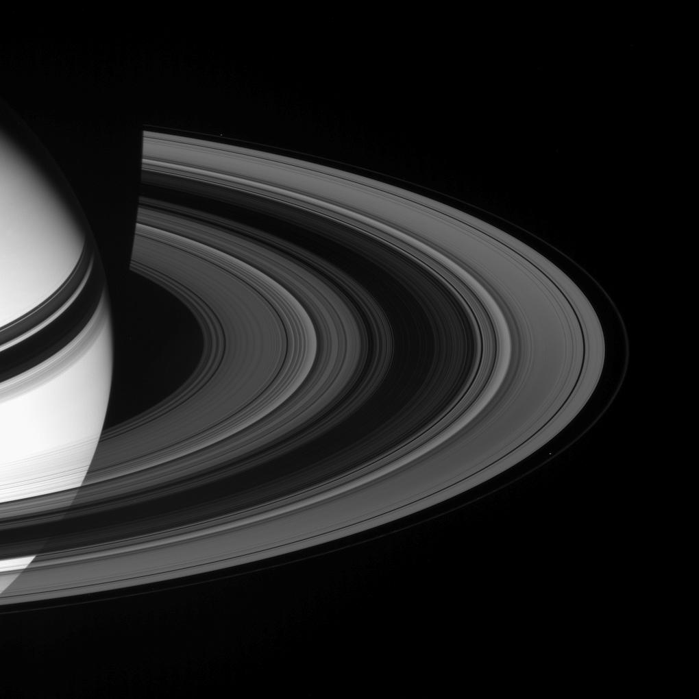 Saturn, it's rings, and the moons Prometheus and Pandora