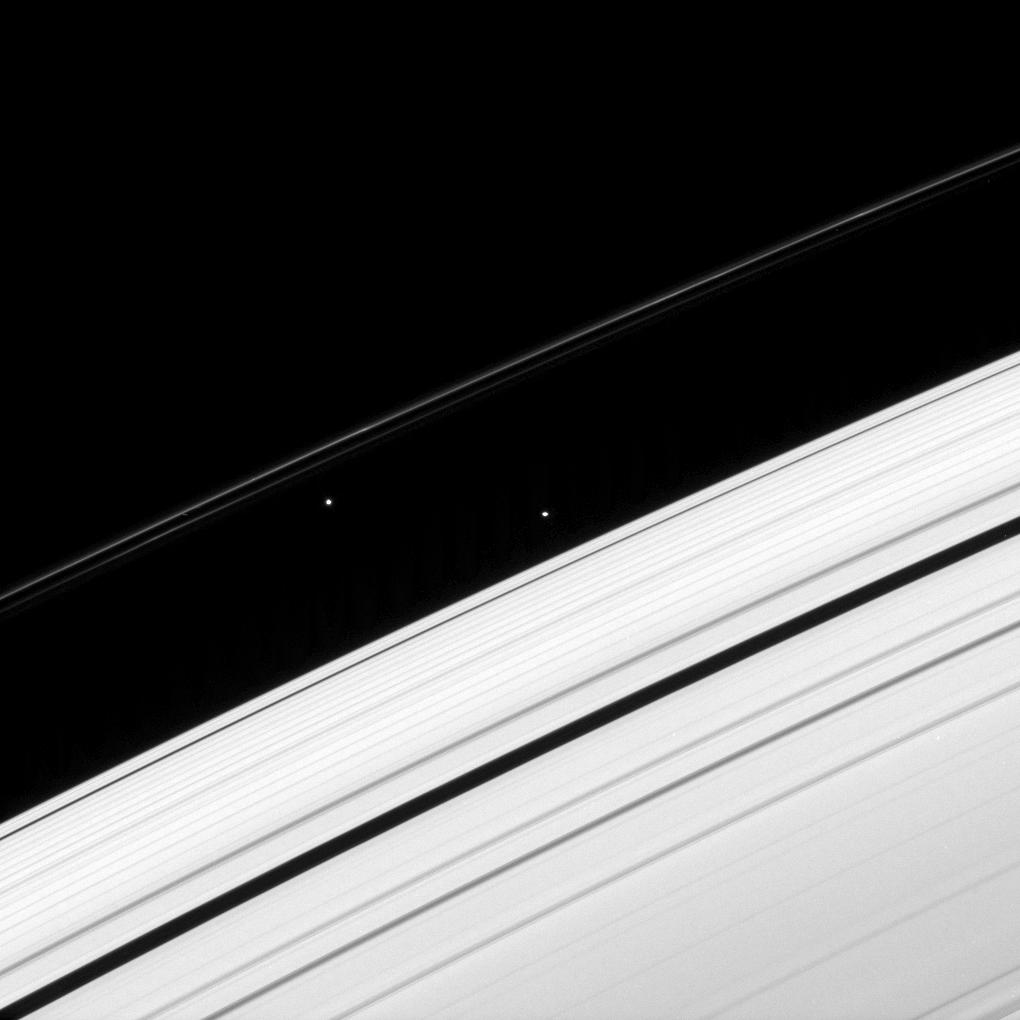 Saturn's rings,  Atlas and  Prometheus