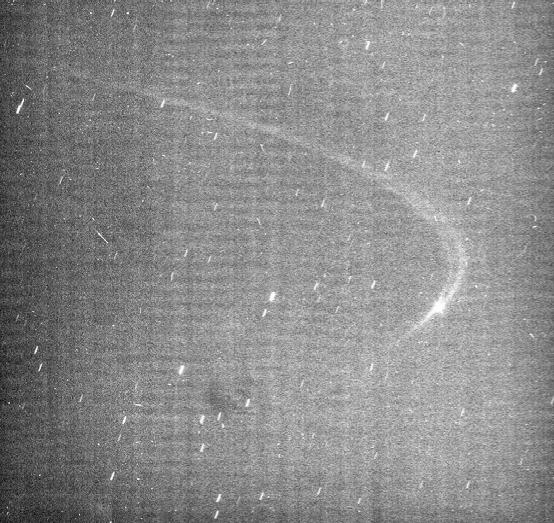 A faint arc of material orbiting with Saturn's small moon Anthe