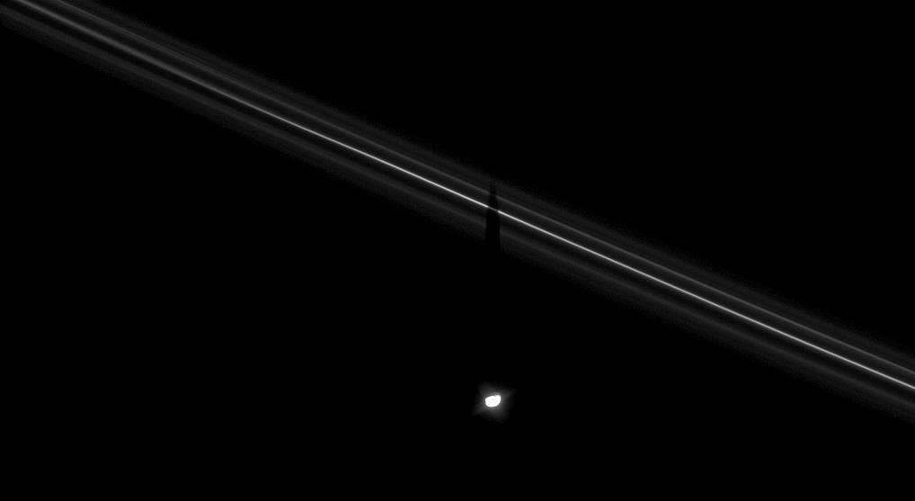 Saturn's moon Pandora casts its shadow upon the F ring.