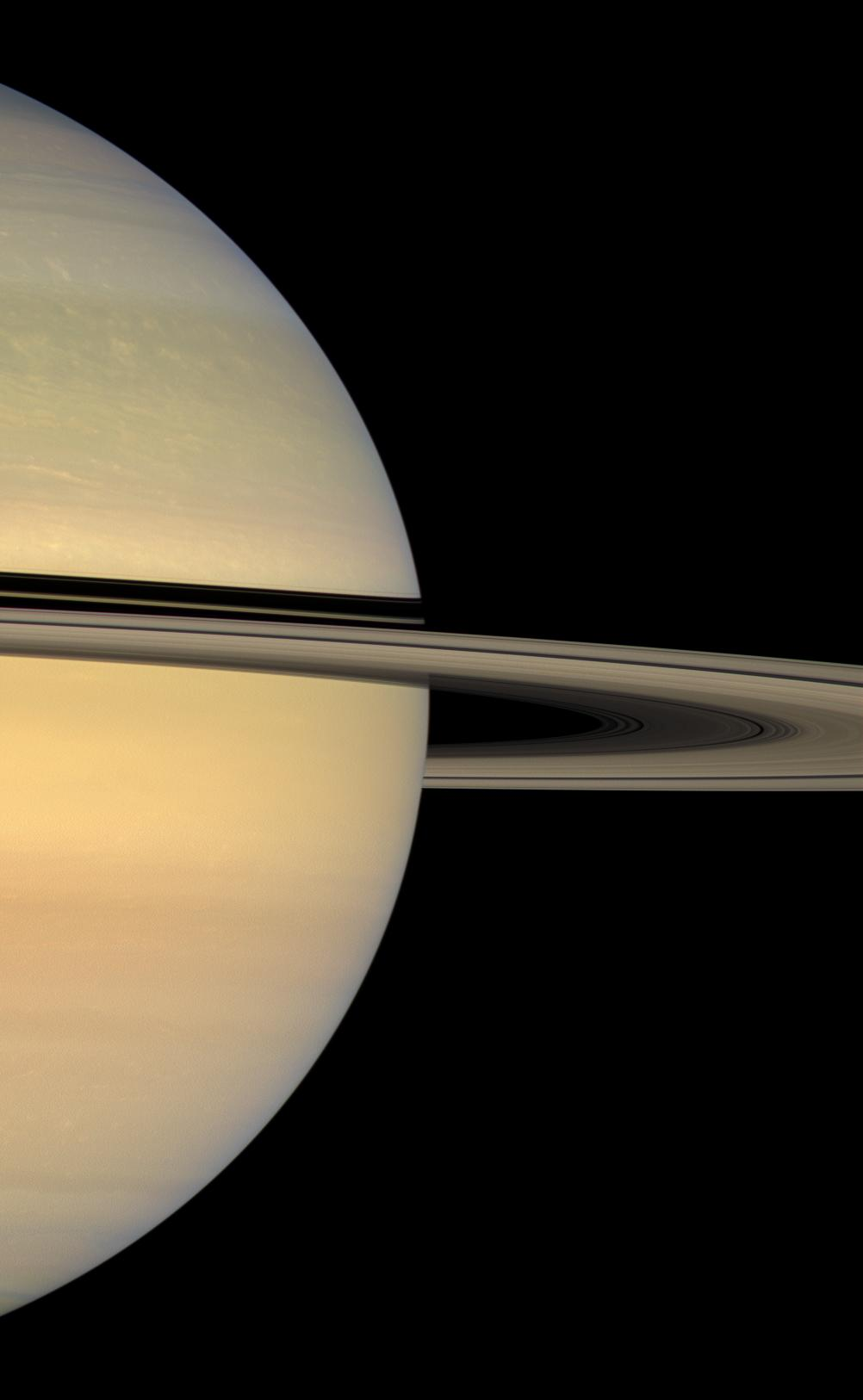sunlit face of Saturn's rings, whose shadows continue to slide southward on the planet