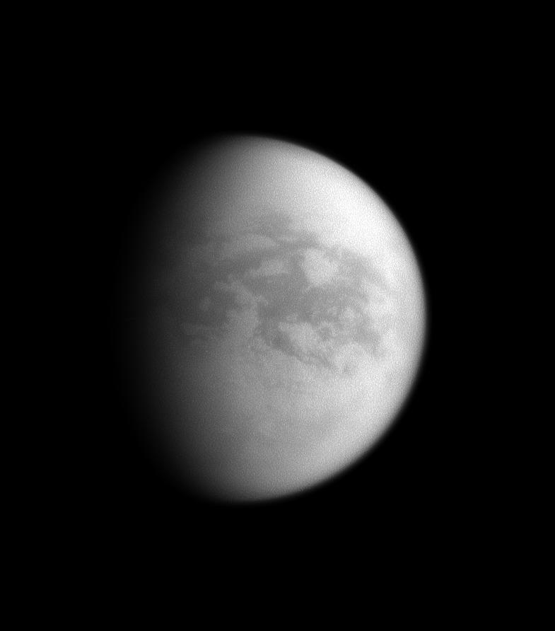 The sun illuminates mainly the trailing hemisphere of Saturn's largest moon, Titan.