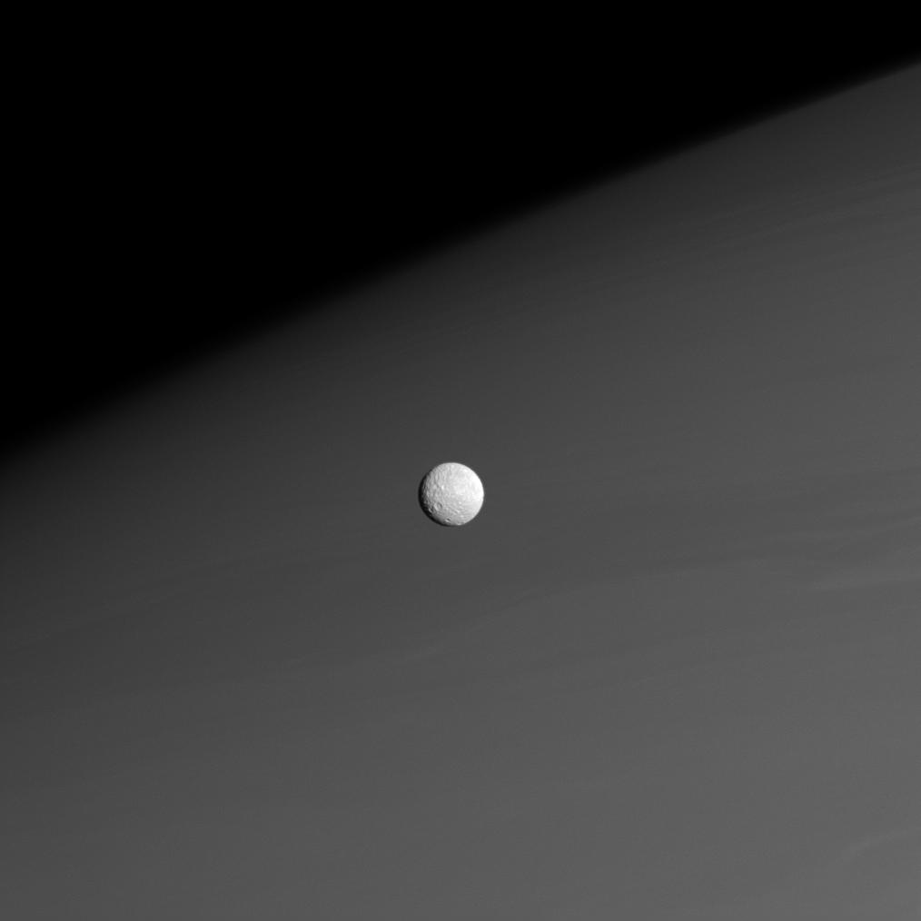 Mimas in front of Saturn