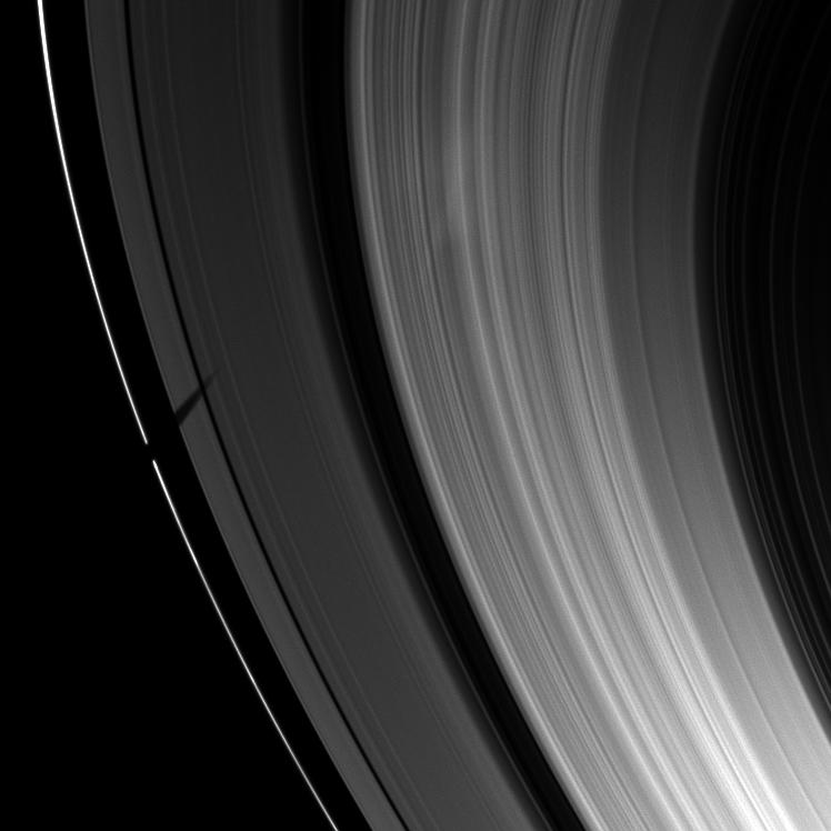 Tethys' shadow over Saturn's rings