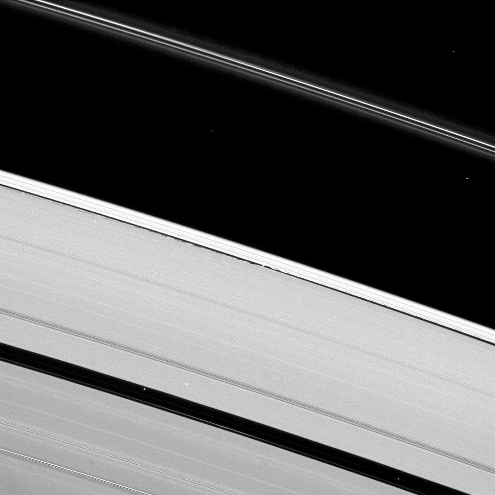 Saturn's moon Daphnis creates waves of disturbance in the Keeler Gap