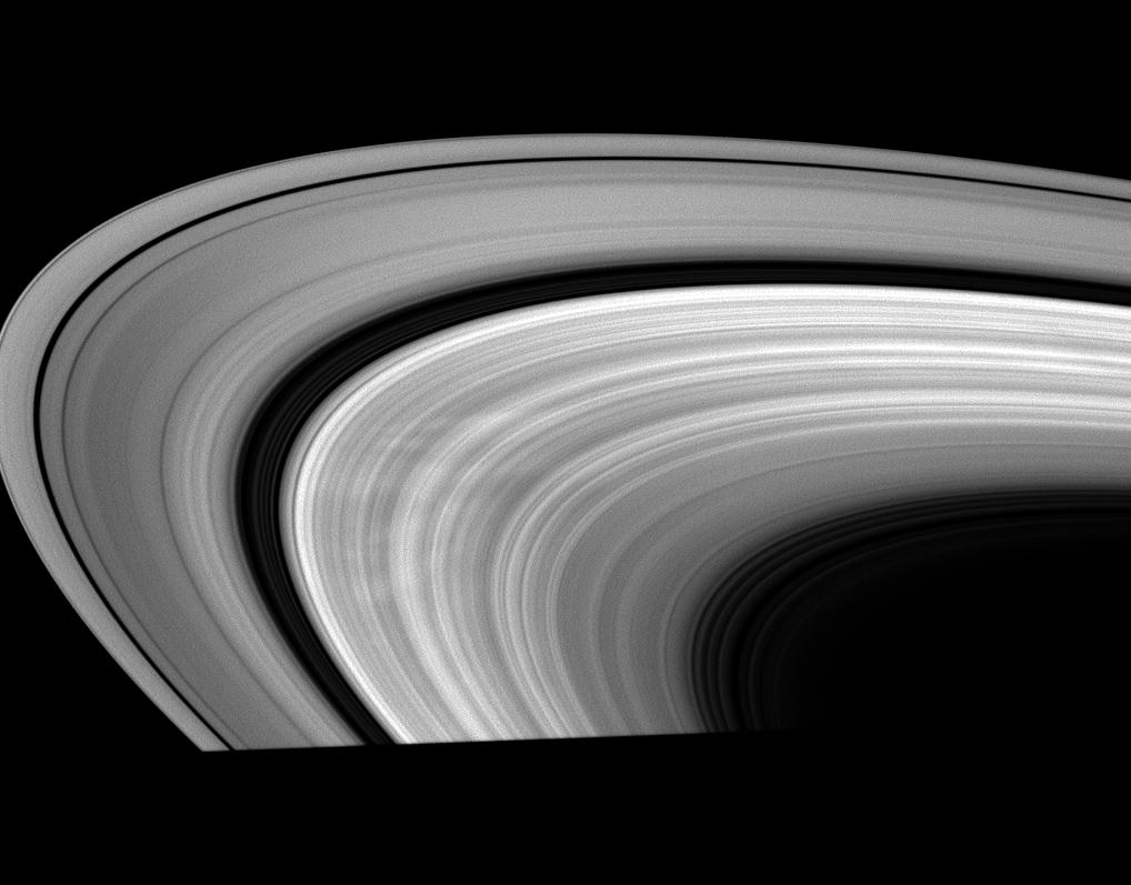 This low-phase Cassini image shows bright areas between dark spokes in Saturn's B ring.
