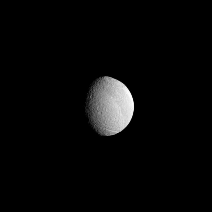 The huge Odysseus Crater disfigures the face of Saturn's moon Tethys.