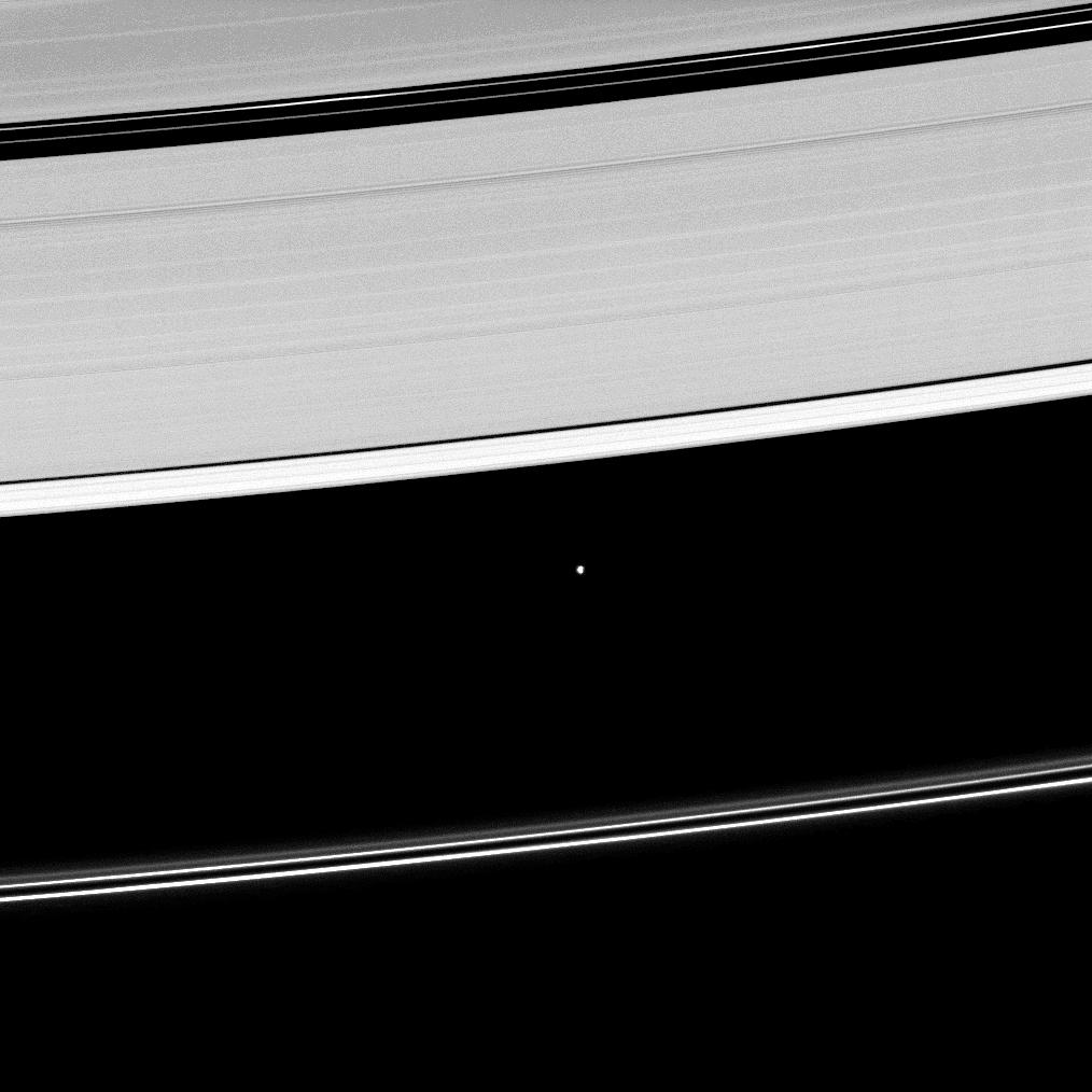 Saturn's moon Atlas, shown at the center of this image, orbits within the Roche Division separating the A ring from the tenuous F ring.